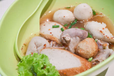 Asian tradition noodle with fishball in bowl photo