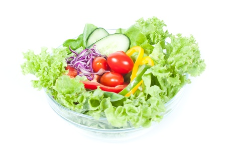 Fresh green vegetable salad in glass bowl on white background photo