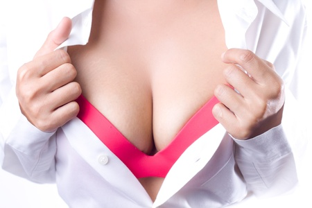red breast: Sexy  asian model woman showing her sexy breast in red lingerie with shirt opened  by hand  on white background
