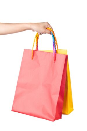 Lady hand holding red paper shopping  bag with  beautiful  color rope handle on white background Stock Photo - 17451998