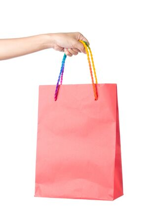 Lady hand holding red paper shopping  bag with  beautiful  color rope handle on white background Stock Photo - 17451997