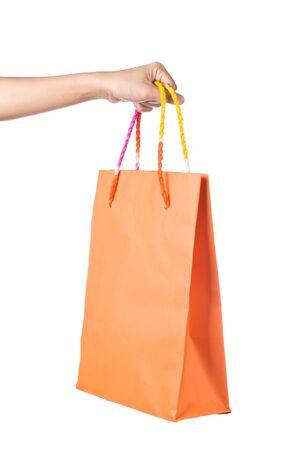 Lady hand holding orange paper shopping  bag on white background Stock Photo - 17451976