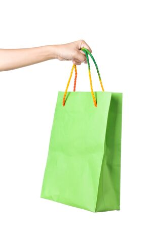 Lady hand holding green paper shopping  bag with  beautiful  color rope handle on white background Stock Photo - 17451988