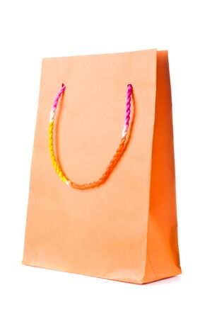 Orange  paper  shopping bag with beautiful color mixed rope handle on white background Stock Photo - 17452000