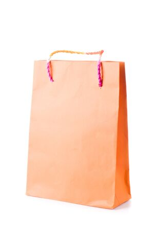 Orange  paper  shopping bag with beautiful color mixed rope handle on white background Stock Photo - 17451993