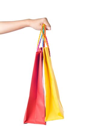 Lady hand holding orange and green paper shopping  bag with  beautiful  color rope handle on white background Stock Photo - 17451984