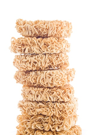 Stack of raw instant noodle on white background photo