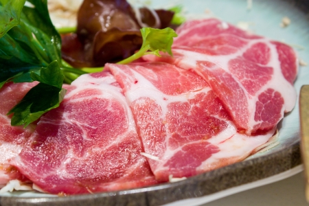 Raw fresh meat in sukiyaki restaurant with  vegetable and noodle