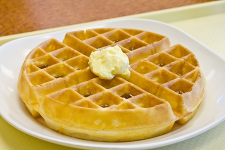 Tradition waffle with butter in white plate  on  the table photo