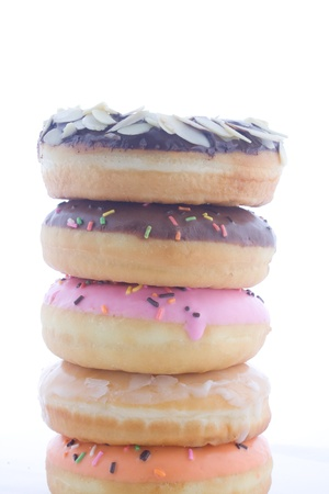 Stack of colorful sweet donut on white background photo