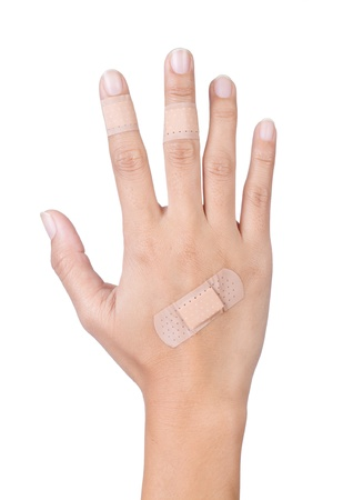 Injured hand and finger covered by plaster on white background Stock Photo - 17625796