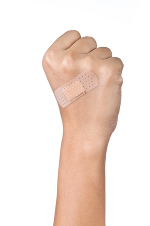 Injured hand with plaster on white background Stock Photo - 17625823