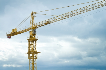 Crane at the construction site against blue dark sky Stock Photo - 17691404