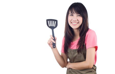 teflon: Young asian woman housewife with apron on white background
