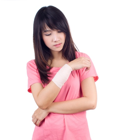 Young asian woman with an injured arm wrapped in an Elastic Bandage Stock Photo - 17667924