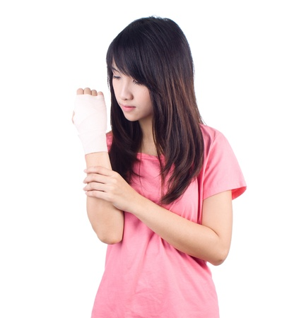 Young asian woman with an injured arm wrapped in an Elastic Bandage Stock Photo