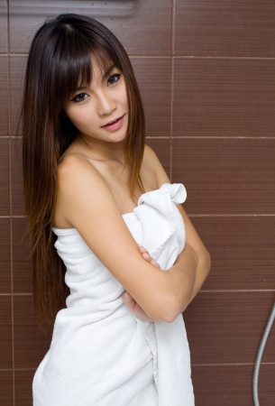 wrapped in a towel: Beauty female portrait with a towel wrapped in the bathroom Stock Photo
