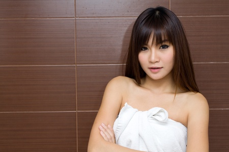 towel wrapped: Beauty female portrait with a towel wrapped in the bathroom Stock Photo