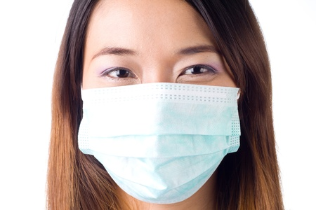Nurse wearing a mask on white background photo