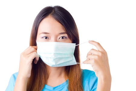 Beautiful asian Nurse Pulling her mask on her face on white background