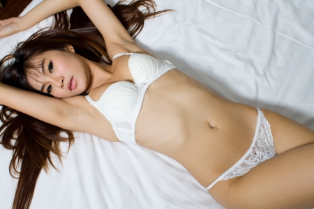 Sexy asian woman in white sexy lingerie Stock Photo