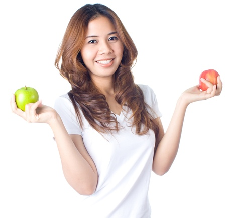 Young healthy woman holding green and  red apple on white background photo