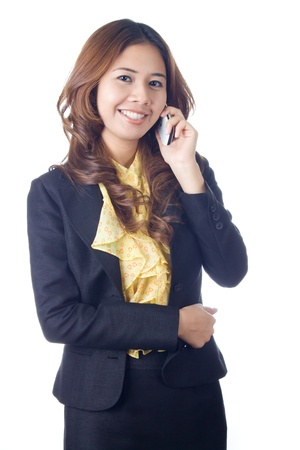 Businesswoman talking on mobile phone on white background