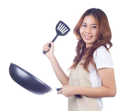 Beautiful blonde woman housewife holding pan on white background Stock Photo - 18064287