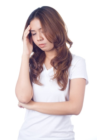 Young unhappy womangetting headache holding her forehead in pain Stock Photo