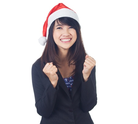 Young excited asian  business  woman smiling with santa hat on white background photo