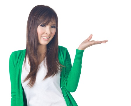 Young Woman gesturing, presenting something on white background photo