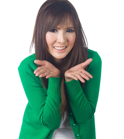 Portrait of a cheerful happy young  asian  woman gesturing on white background photo