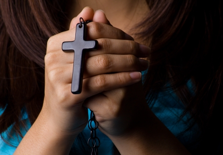 Young woman  praying with rosary in hand Stock Photo - 19098181