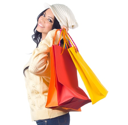 Shopping woman in sweater with colorful shopping bag on white background