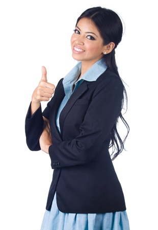 Young business woman gesturing thumbs up sign over white background photo