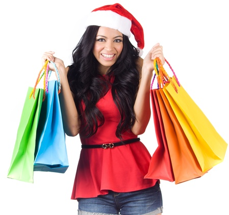 christmas shopping: Christmas Shopping, Asian woman holding colorful shopping bags wearing santa hat on white background Stock Photo