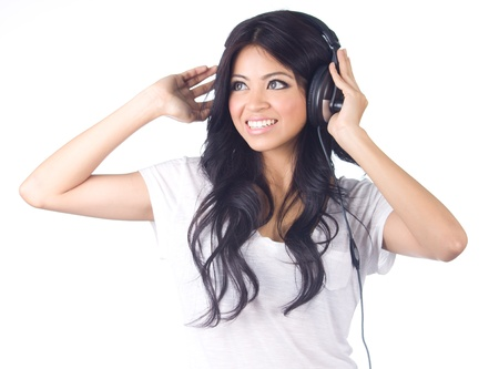 Young asian woman listening to music on white isolated photo