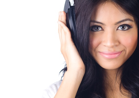 Young happy woman listening to music on white isolated photo