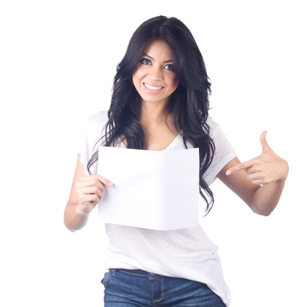 Young asian woman showing empty blank paper card sign with copy space for text on white isolated photo