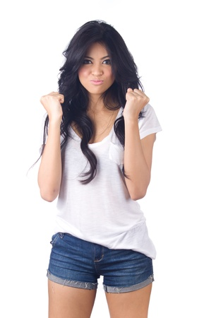 Beautiful young  asian woman in blue short jeans on white background photo