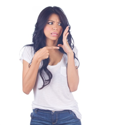 Woman whispering and pointing at someone on white background photo