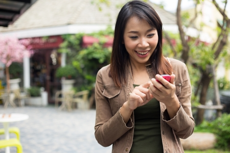 Woman talking on mobile phone at outdoor photo