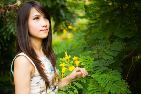 Young beauty woman in nature photo