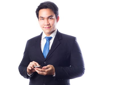 Young Businessman with Smartphone on White photo