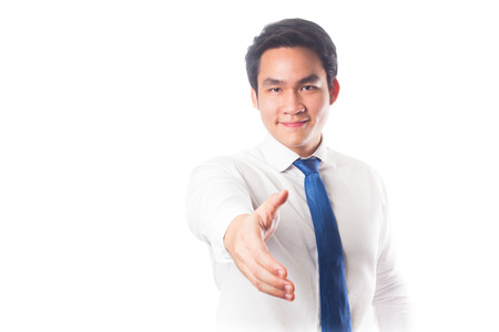 Business man with hand extended to handshake, isolated over white photo