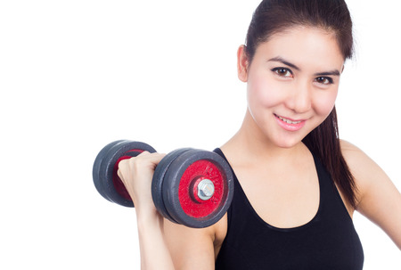 Fitness woman working out with free weights,dumbbell. photo