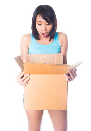 Woman carrying moving boxes on and surprise on white background photo
