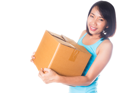 Woman carrying moving boxes on white background photo