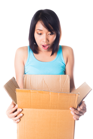 Woman carrying boxes look surprise on white background photo