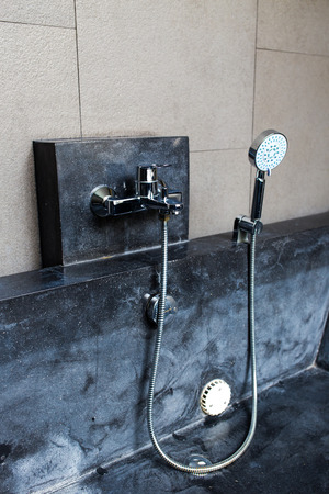 Modern Jacuzzi with faucet and hand shower in bathroom photo